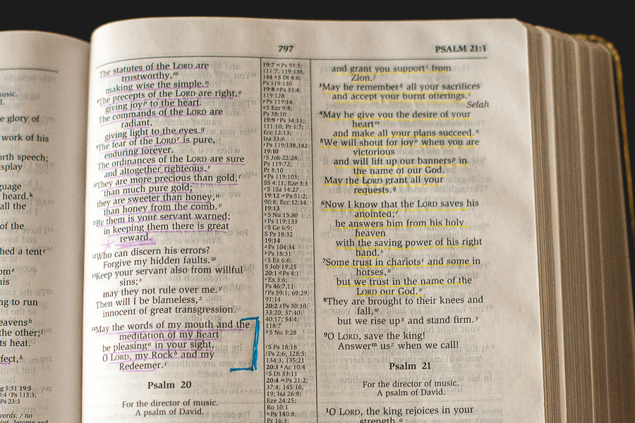 picture Holy Bible open and Bible verse passages highlighted, showing scriptures to memorize