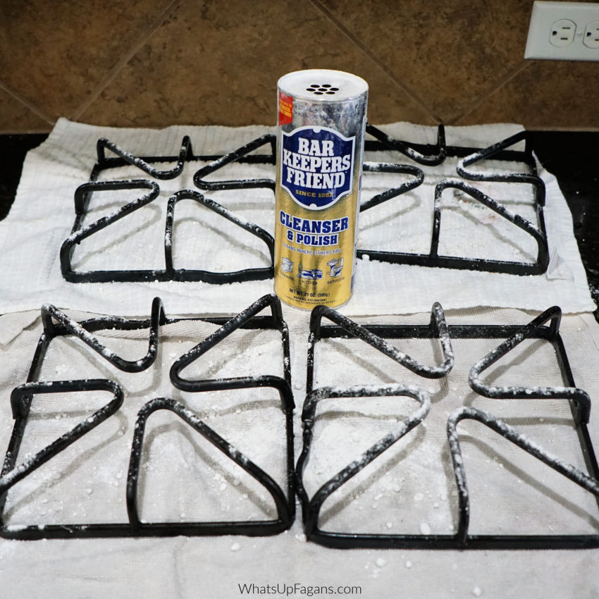 cleaning gas stove grates using canned powdered Bar Keepers Friend cleanser