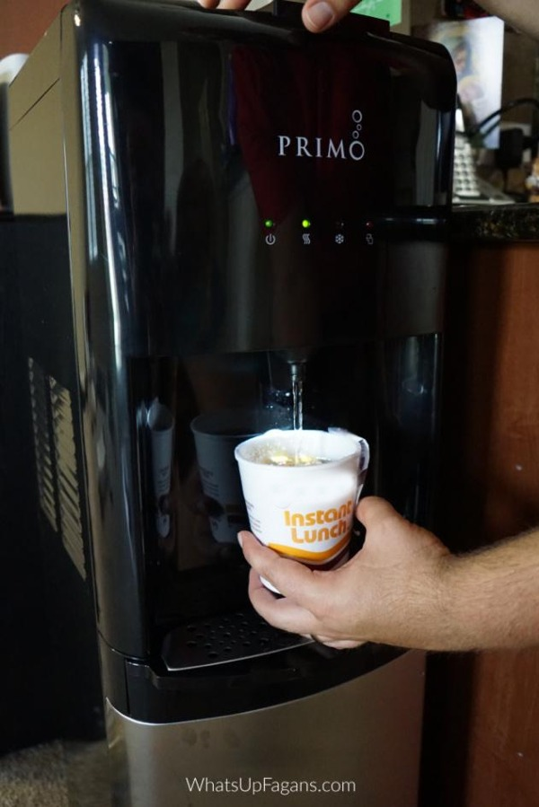 primo hot water dispenser being used to cook instant ramen of noodles