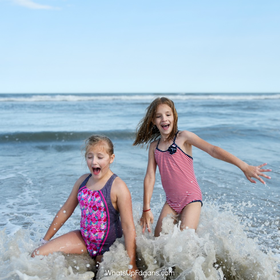 twin 9-year-old girls playing a beach game for kids called don't look back