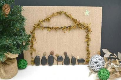 creative rock nativity craft on burlap canvas