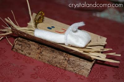 popsicle stick baby Jesus nativity craft of manger and Jesus