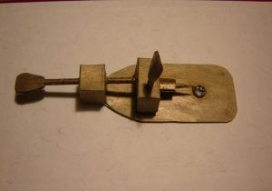 A small rectangular piece of cardboard with a handle and lens