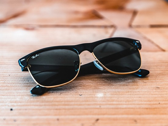 Ray-Ban Sunglasses Laying on a Table