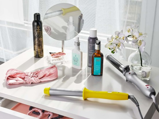 Dry Shampoo and other hair product on a vanity.