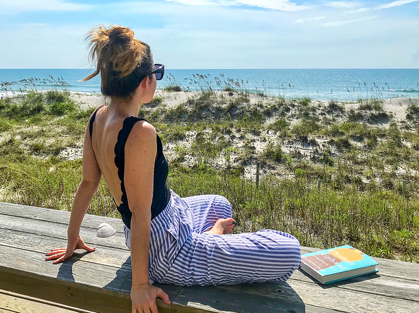 Anne wearing Rent the Runway pants at the beach.
