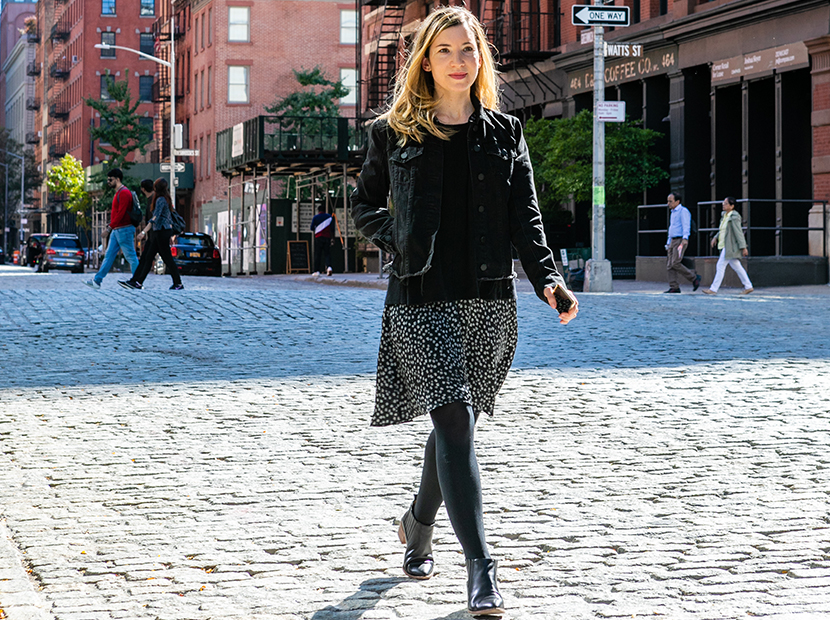 Anne walking down the street in NYC wearing a Rent the Runway dress.