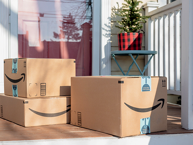 Amazon prime packages sitting on the front porch.