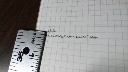 handwriting next to a ruler