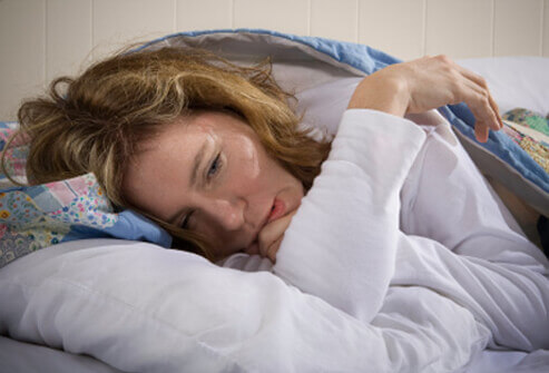 1008-10-chronic-fatigue-syndrome-s1-woman-suffers-from-cfs-in-bed