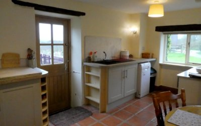Kitchen and stable door to the garden at Otter Cottage, Wheatland Farm Eco Lodges