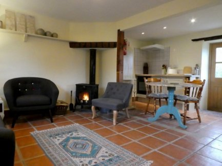 Living room at Otter Cottage, Wheatland Farm Eco Lodges