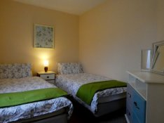 Twin room at Otter Cottage, Wheatland Farm Eco Lodges