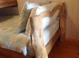 Hand made bed in Wheatland Farm's Honeysuckle Lodge