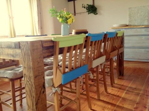 recycled chapel chairs in Balebarn eco lodge