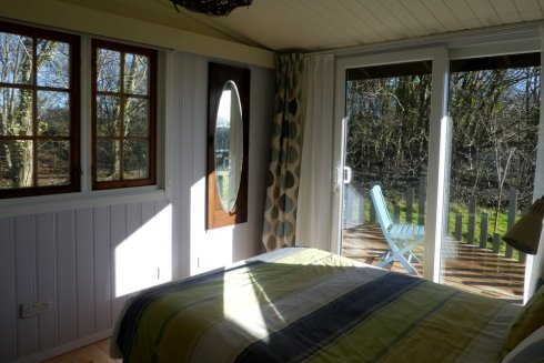 The master bedroom is light, with slidiing doors to its own balcony