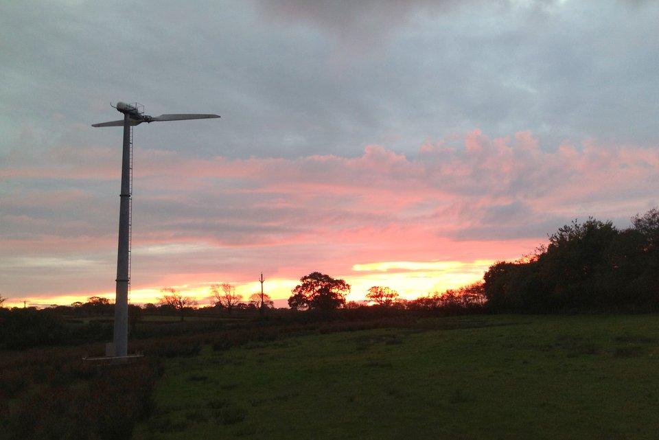Wheatland Farm's turbine at sunset