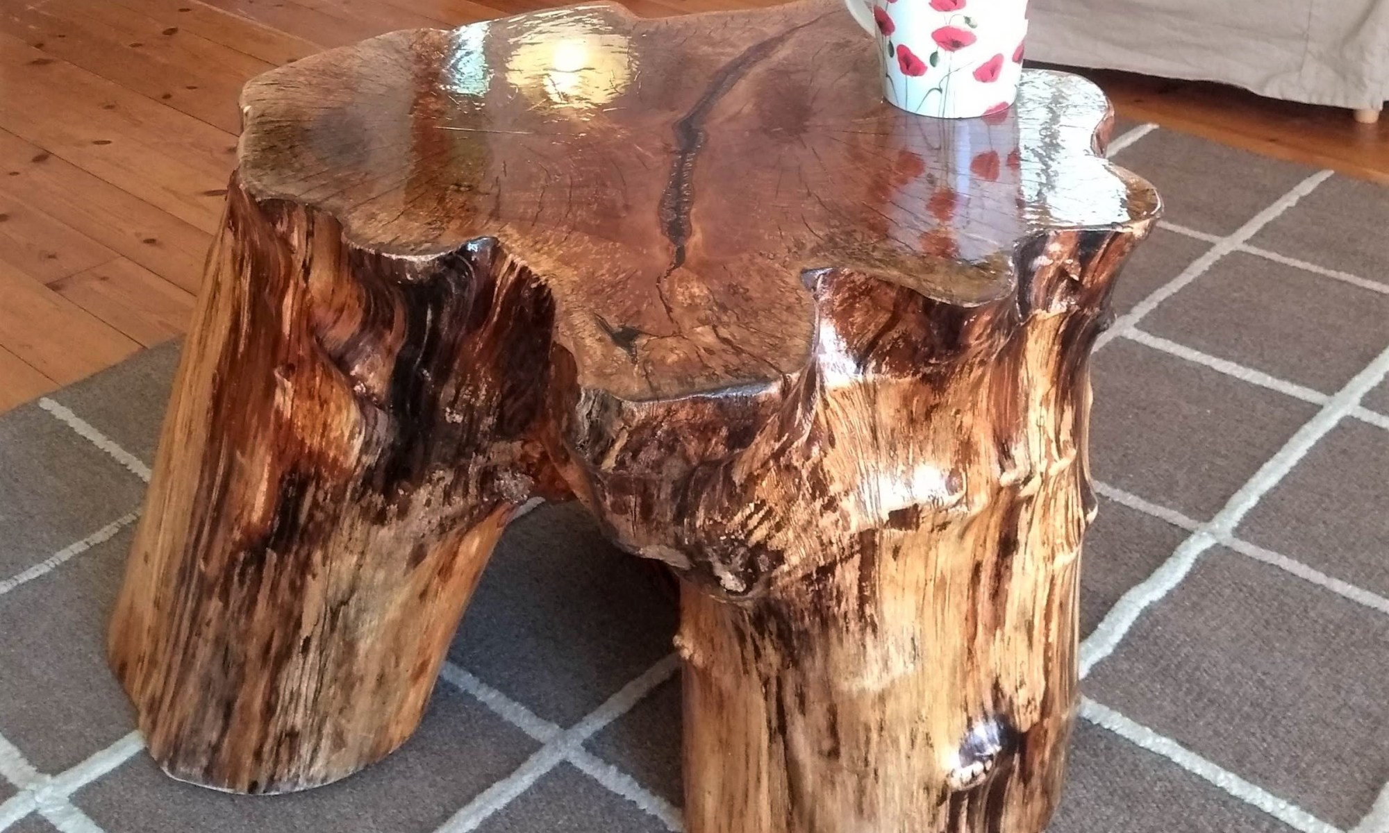 Quirky coffee table made from a tree trunk at Nuthatch Eco Lodge, Wheatland Farm, Devon