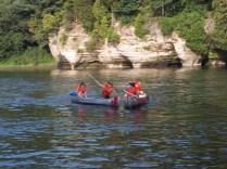 2 canoes paddling and racing