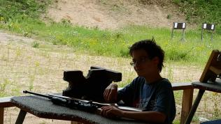 Jimmy readies his rifle at the range