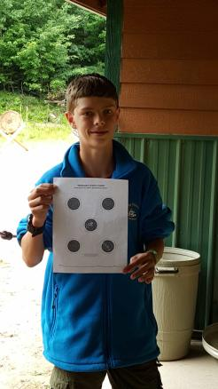 Simon earns his merit badge at the rifle range