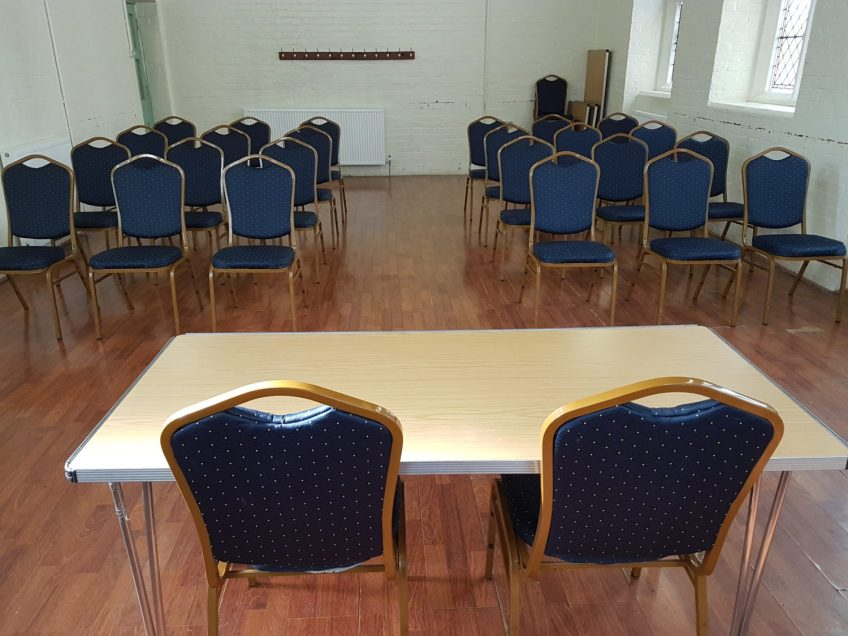 a picture of the small hall set up for a meeting