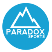 """A blue circle with the outline of a mountain in white with """"Paradox Sports"""" written in white."""