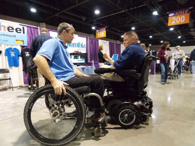Pat Dougherty explains FreeWheel to a new fan at a recent Abilities Expo.