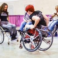 women in wheelchairs dancing at Abilities Expo