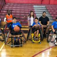 Coach Luis Amaro with his wheelchair basketball team.
