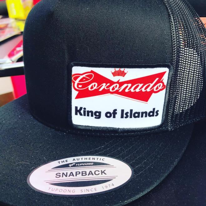 """A hate with a patch that reads, """"Coronado, King of Islands."""""""