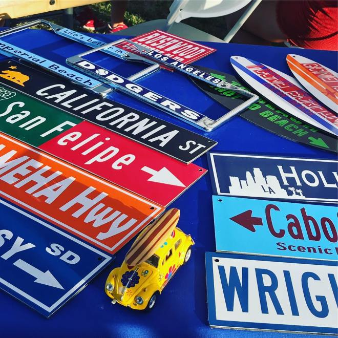 Multiple signs of various colors and text on a table.