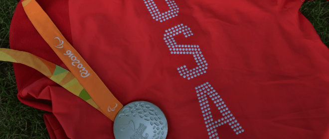 A red Team USA Wheelchair Rugby jersey with a silver medal from the 2016 Paralympic Games.