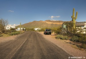 View down east side of campground. RV in site #48 on right with #50 behind it.