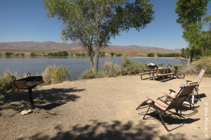 """View of our lovely """"sitting area"""" showing grill (left) & picnic table (right)"""