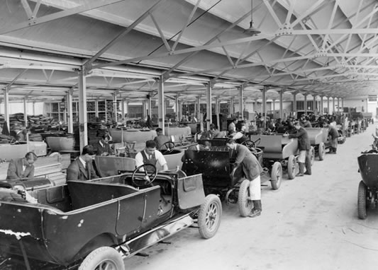 This shot shows the body mounting shop at Morris Motors in Oxford, in 1925