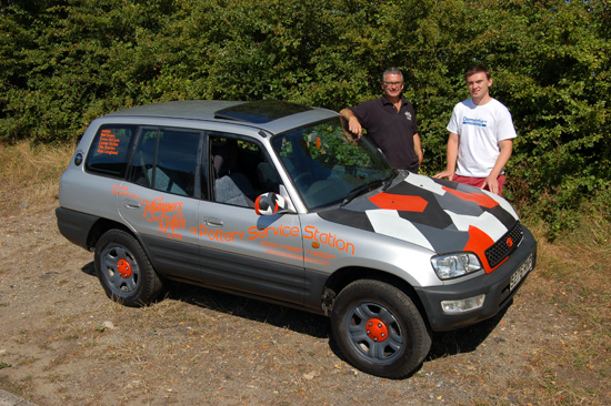 Ready for the journey… Major sponsor Andy Saunders (left) and Niall Brown (right) with the 16 year old Toyota RAV4 in which Niall and his pals are driving to Bratislava in Slovakia, raising money for Dementia UK.