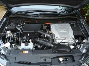 The underbonnet compartment accommodates both the petrol engine and the forward electric motor (there's another one at the rear of the vehicle!).