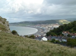 As the tramcars make their way up and down the tracks, respectively to and from the Great Orme, views like this across the town of Llandudno and its beach, can be seen. Even when the weather's 'changeable', the scenery's beguiling.