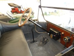 The Ford's controls; a steering wheel, two hand levers, three pedals and a floor-mounted parking brake lever (please see text).