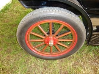 Large diameter (30 x 3 in. front, 30 x 3.5in. rear), wooden-spoked 'artillery' wheels.