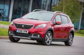 Peugeot 2008 Compact SUV Allure side front action copy