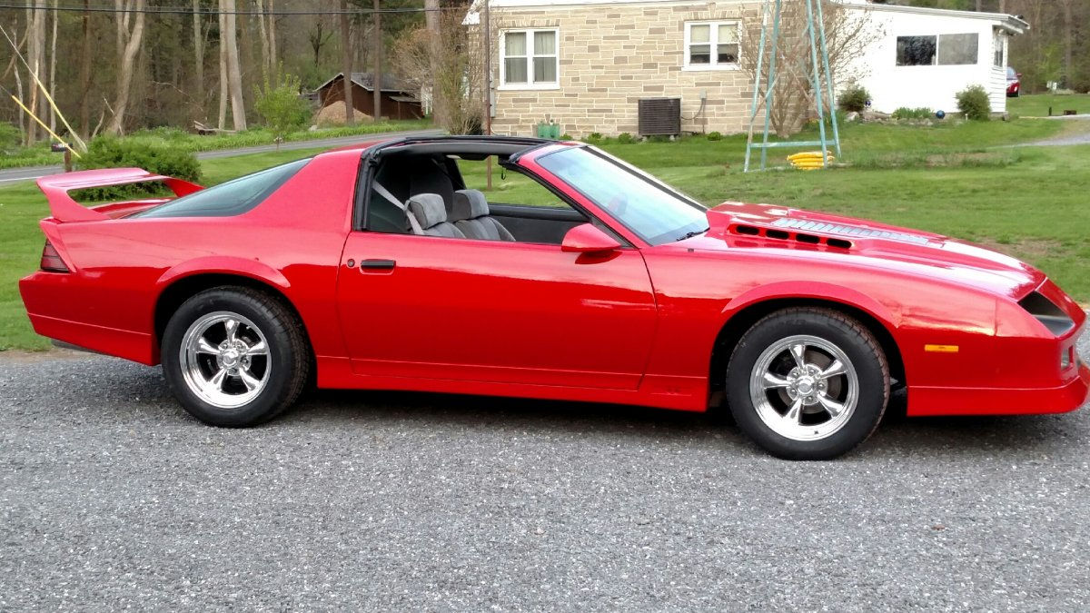 hight resolution of 1985 chevy iroc z with 16x8 american racing torq thrust ii s