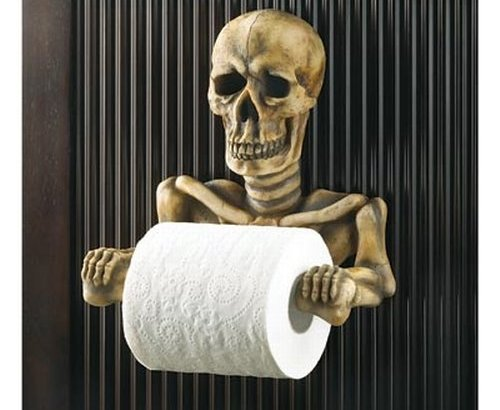 Friendly skeleton toilet paper holder