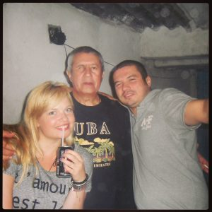 Myself, my adopted Brazilian (God)father and another hostel patron at the favela party.