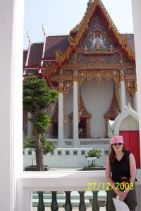 Standing in front of a temple in Bangkok on gem scam tour