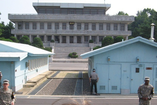 Looking at UN buildings on Korean border at Panmunjeom and seeing North Korean soldiers