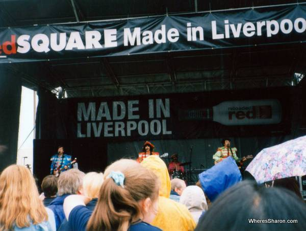 band dressed as the beatles on stage