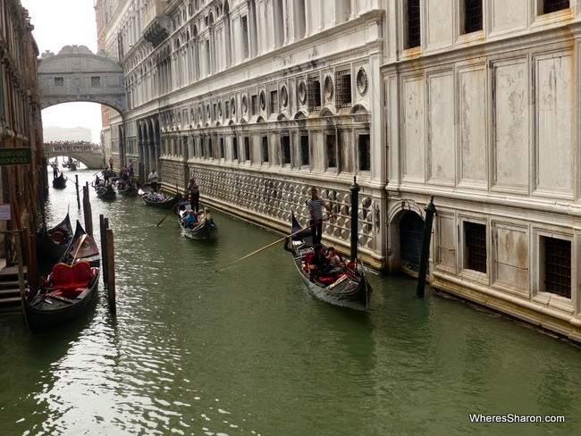 Venice's famous Gondolas cruising past the Doge's palace.