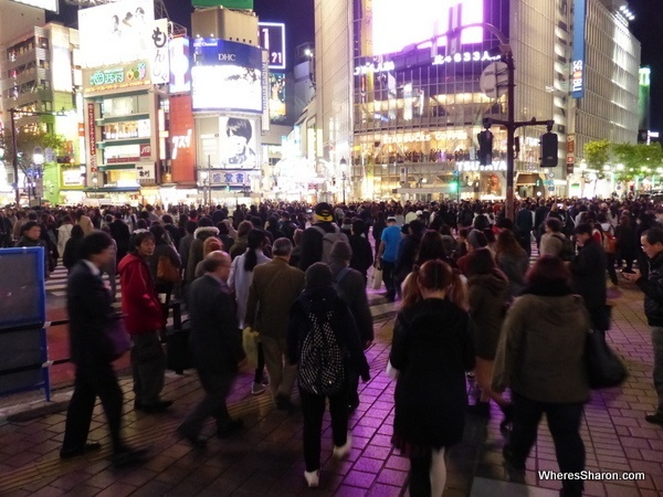 The famous Shibuya Crossing at night.